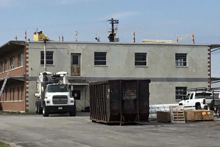 The back of The JDQ Building in 2016 while the old roof was being removed and the new roof installed.