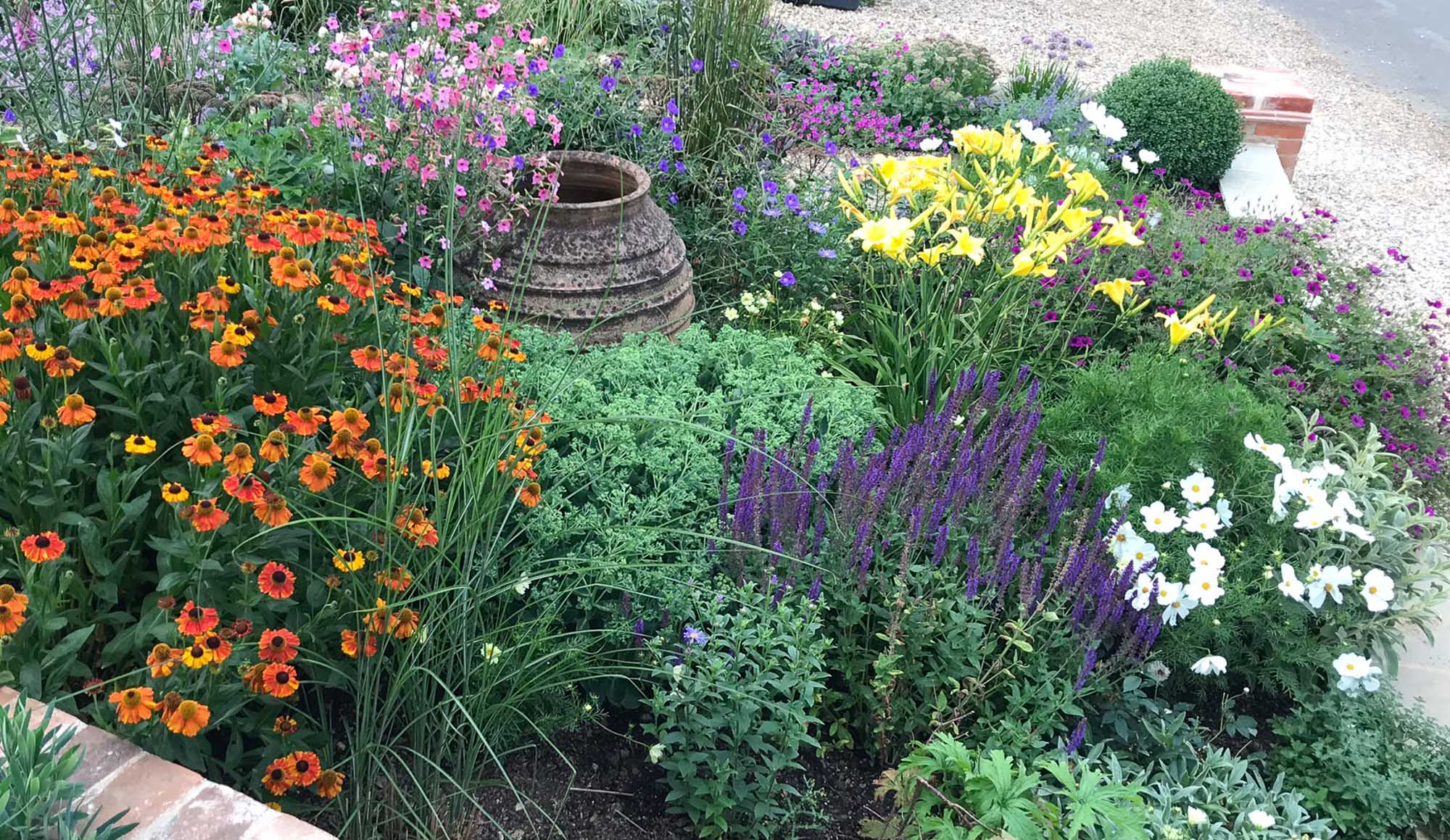 A mix of perennials and summer bedding ensure colour through from June to October