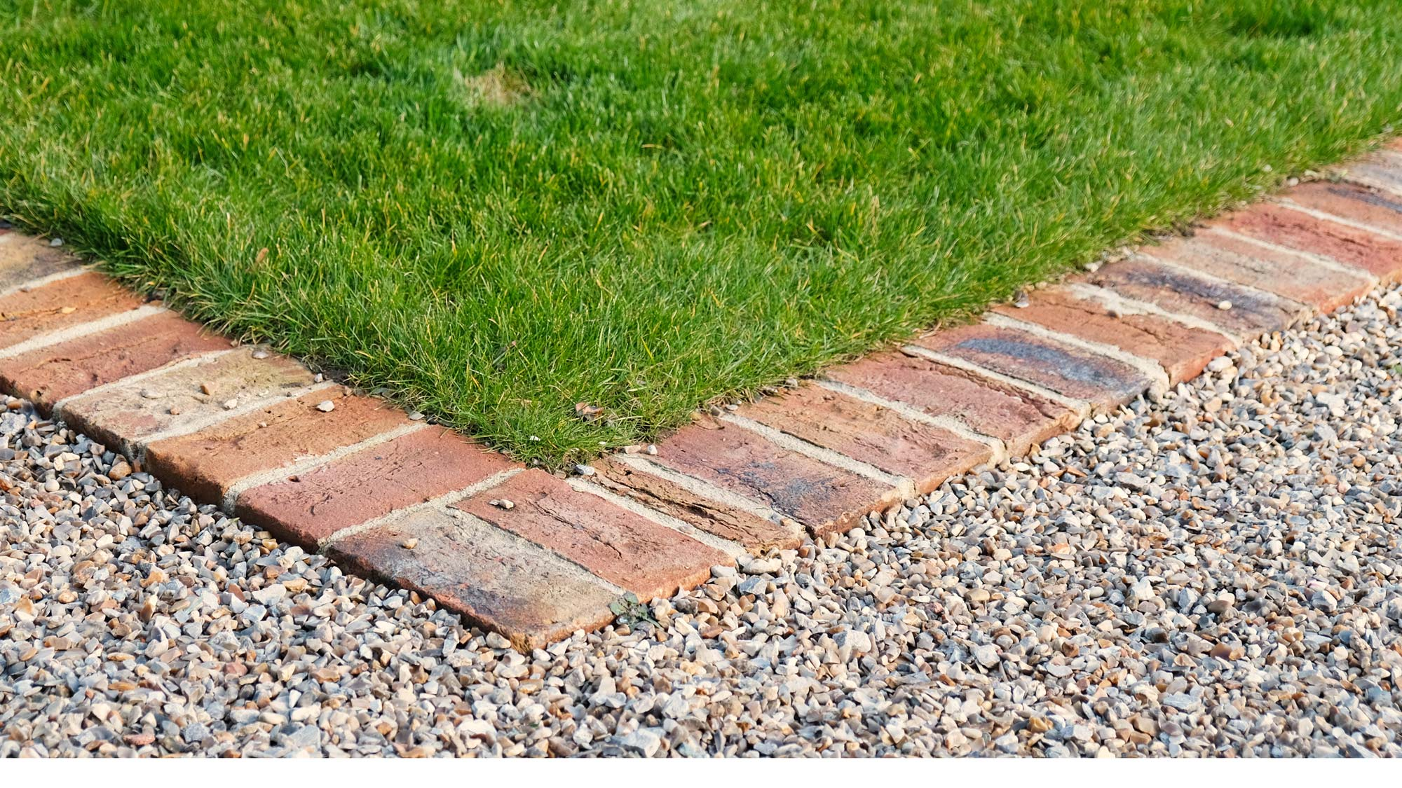 Brick edging clearly defines different areas of the garden and makes it easy to mow up to and over the edge of the lawn.