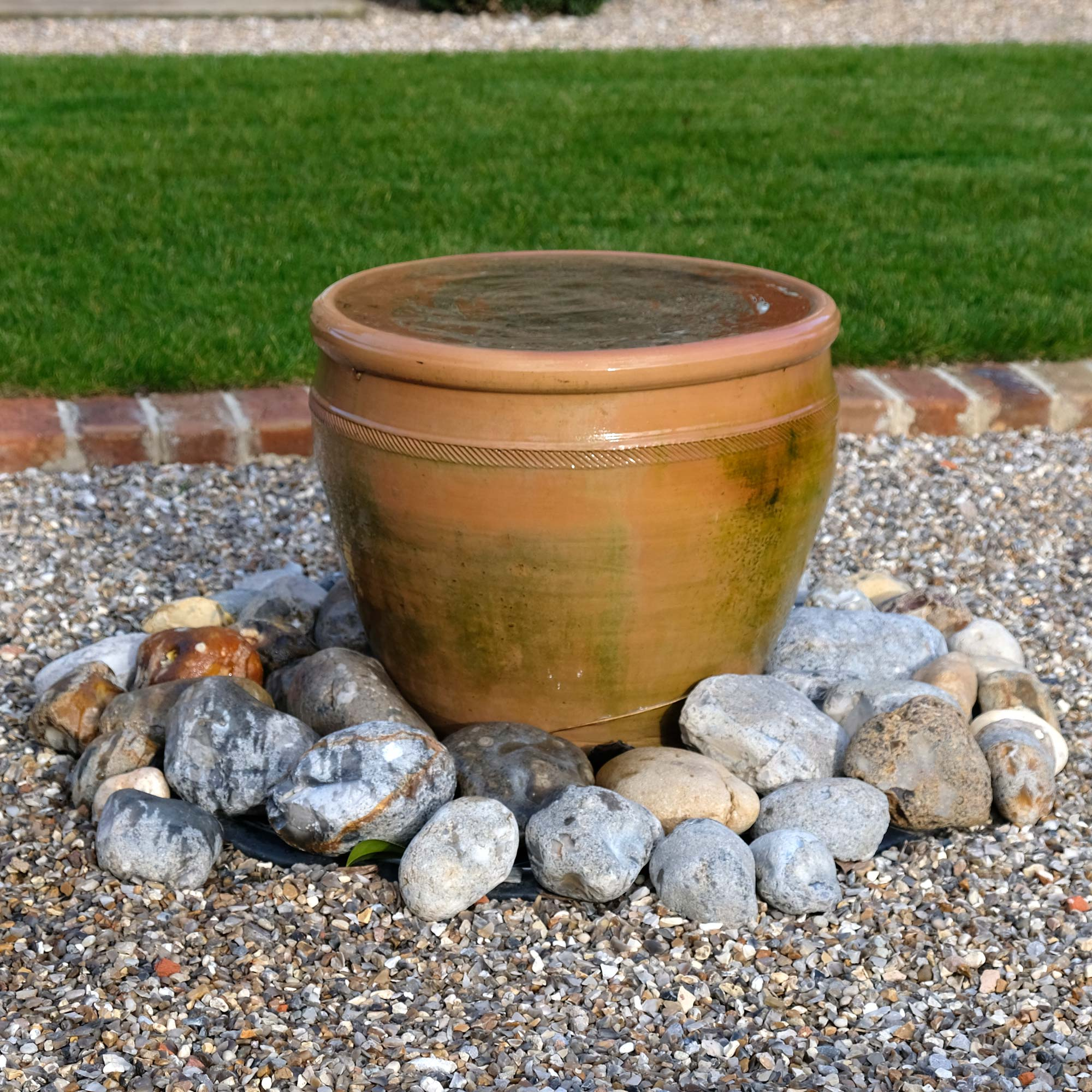 A simple water feature brings the relaxing sound of running water into the garden