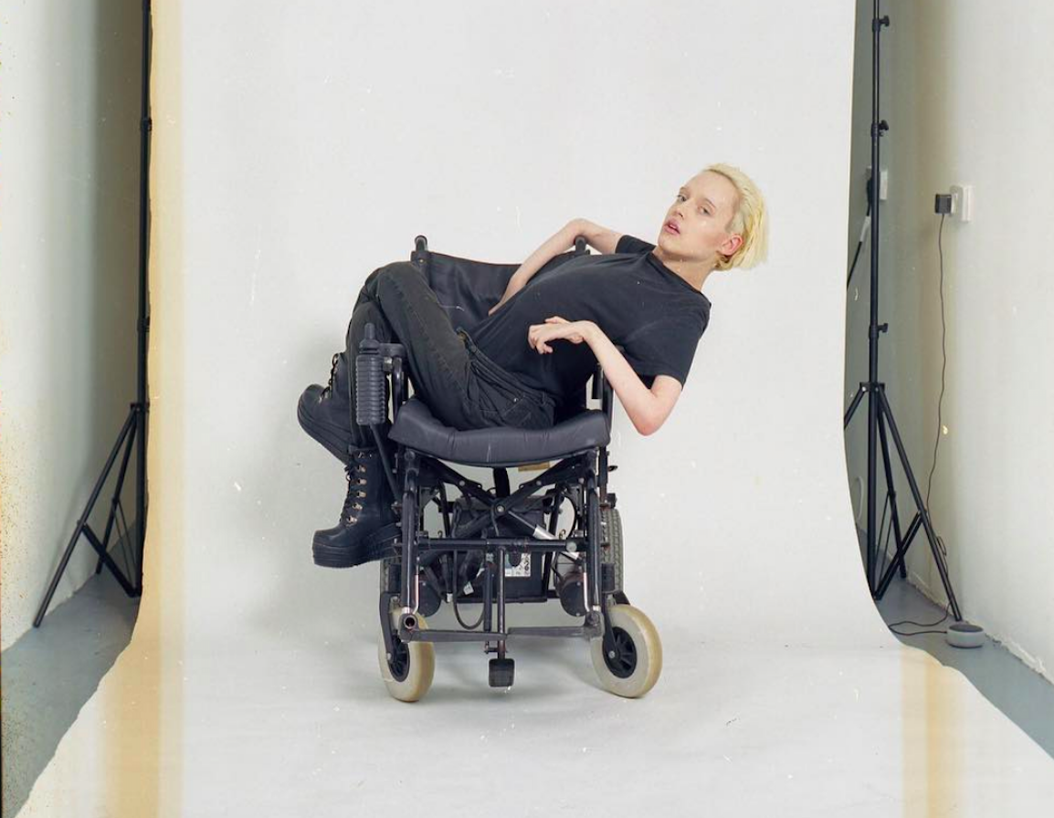 A man with disability in a wheelchair posing in the photo studio as a model. Photo credit Stephen Thomas Smith.