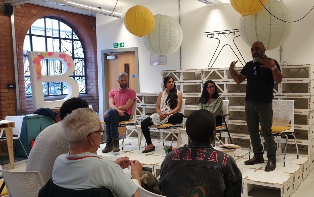 Activist Asad Rehman speaking at the Birmingham LGND meeting