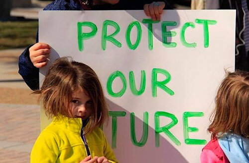 Little girl in Salt Lake City with sign asking to Protect My Future.jpg