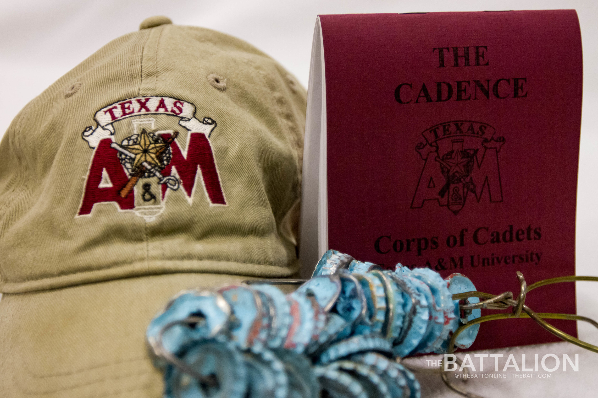 The Cadence, originally authored by Tom Gillis, Class of 1942, is one of the first items given to a fish at the beginning of their time in the Corps of Cadets. It contains information on cadet life, traditions and commonly-used terms.   Photo by Meredith Seaver.