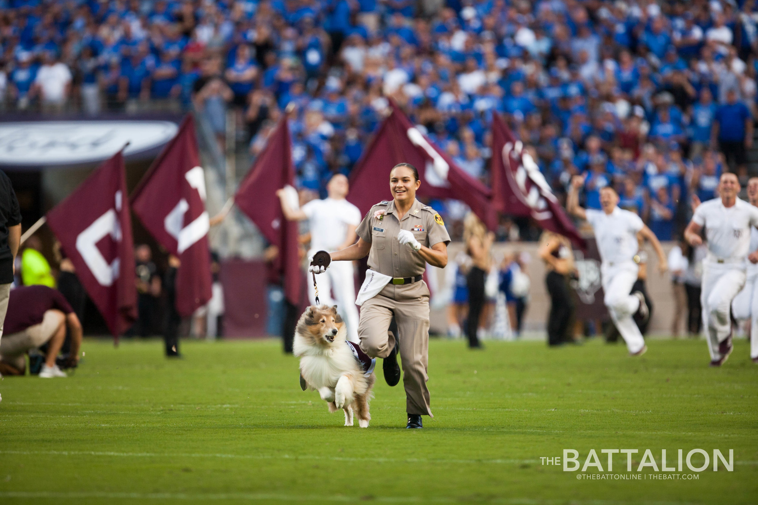 Mia Miller   runs onto Kyle Field with Reveille IX during an Aggie football game.   Photo by Jesse Everett.