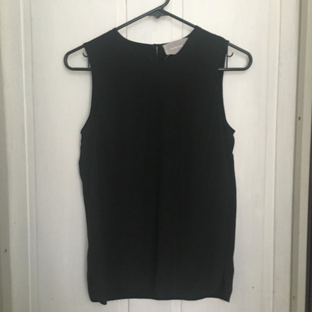 """SIZE: 0 PRICE: $45 BRAND / ITEM NAME: Everlane Silk Shell, Black (from last summer) CONDITION: EUC, first picture is from Everlane  SHIPPING: $7 MATERIAL: Silk  MEASUREMENTS: pit to pit- 17"""", front length from mid shoulder to bottom hem-23.5"""", front length from mid neckline to bottom hem-20.25"""". SELLER: @greteclaire  PROTOCOL: Please tag me and leave your zip code to purchase. Item goes to the first zip code listed. Please DM me your PP email so I can invoice you.  The listed price includes Paypal Invoicing. PLEASE NO GIFTING. If there are backups for this item I will move onto them after 3 hours of sending invoice. HASHTAGS (#nb__):"""