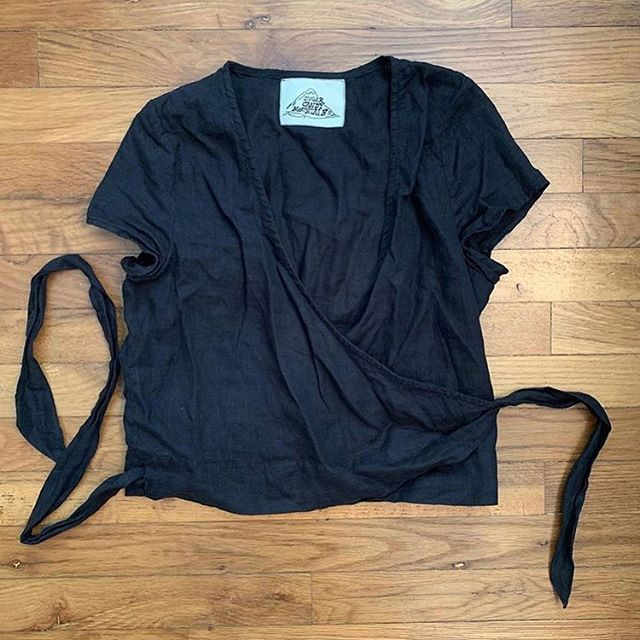 """SIZE: M  PRICE: 55  BRAND / ITEM NAME: Sugar Candy Mountain Wrap Top (Navy)  CONDITION: Excellent, purchased slightly used on instagram, worn for ten minutes, washed before  SHIPPING: $10  MATERIAL: 100% linen  MEASUREMENTS: 17"""" pit to pit  SELLER: @lotte_mari  PROTOCOL: Please tag me and leave your zip code to purchase. Item goes to the first zip code listed. Please DM me your PP email so I can invoice you.  The listed price includes Paypal Invoicing. PLEASE NO GIFTING. If there are backups for this item I will move onto them after 3 hours of sending invoice. HASHTAGS (#nb__):"""