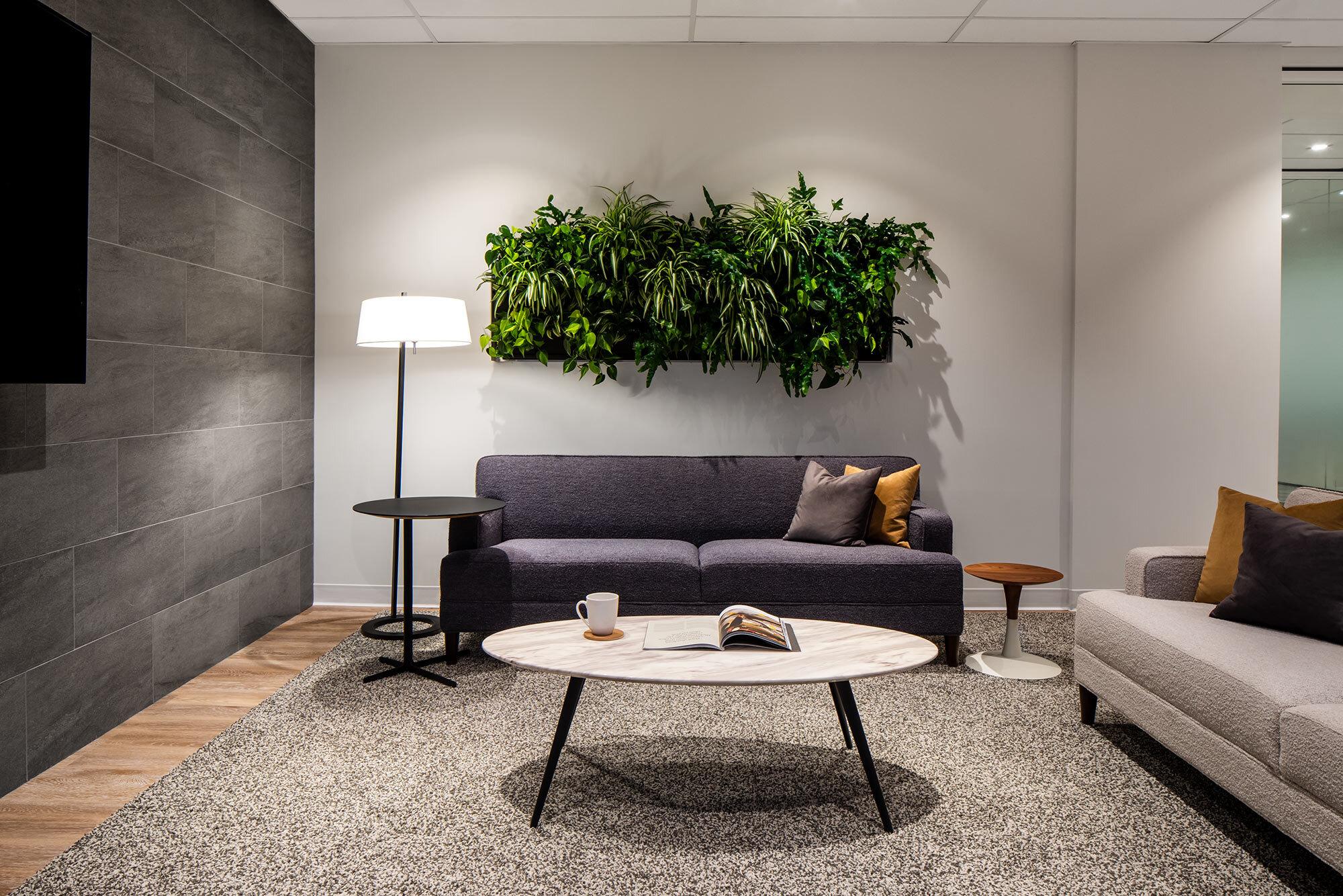 Insurance-interior-design-office-common-area-plant-wall.jpg