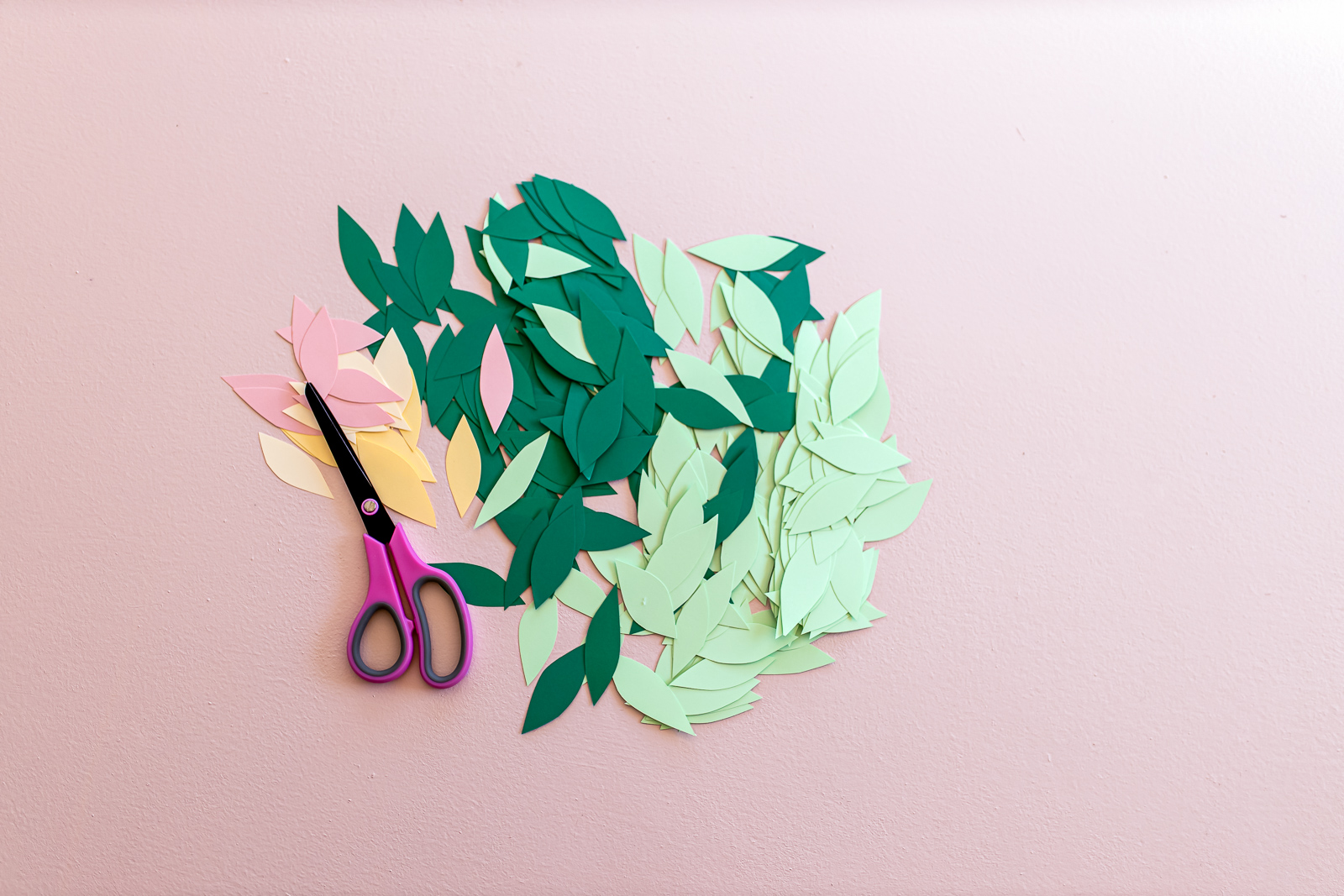 DIY_Paper_Leaf_Baby_Mobile_by_Clever_Poppy_cutting_leaves.jpg