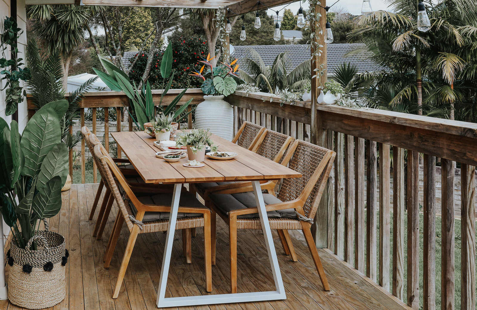 Small_deck_Makeover_two_ways_by_clever_Poppy_tropical_dining.jpg