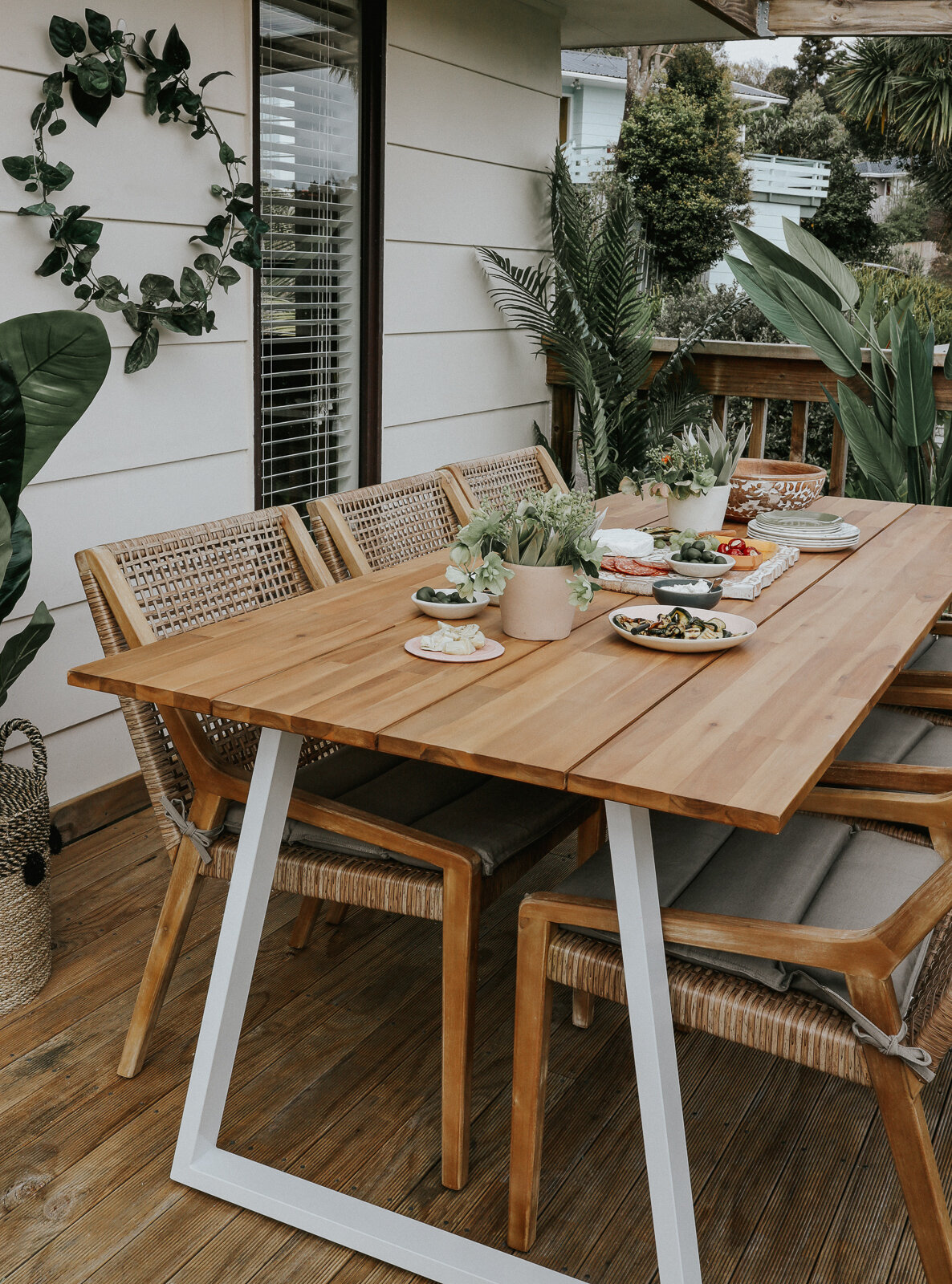 Small_deck_Makeover_two_ways_by_clever_Poppy_tropical_dining5.jpg
