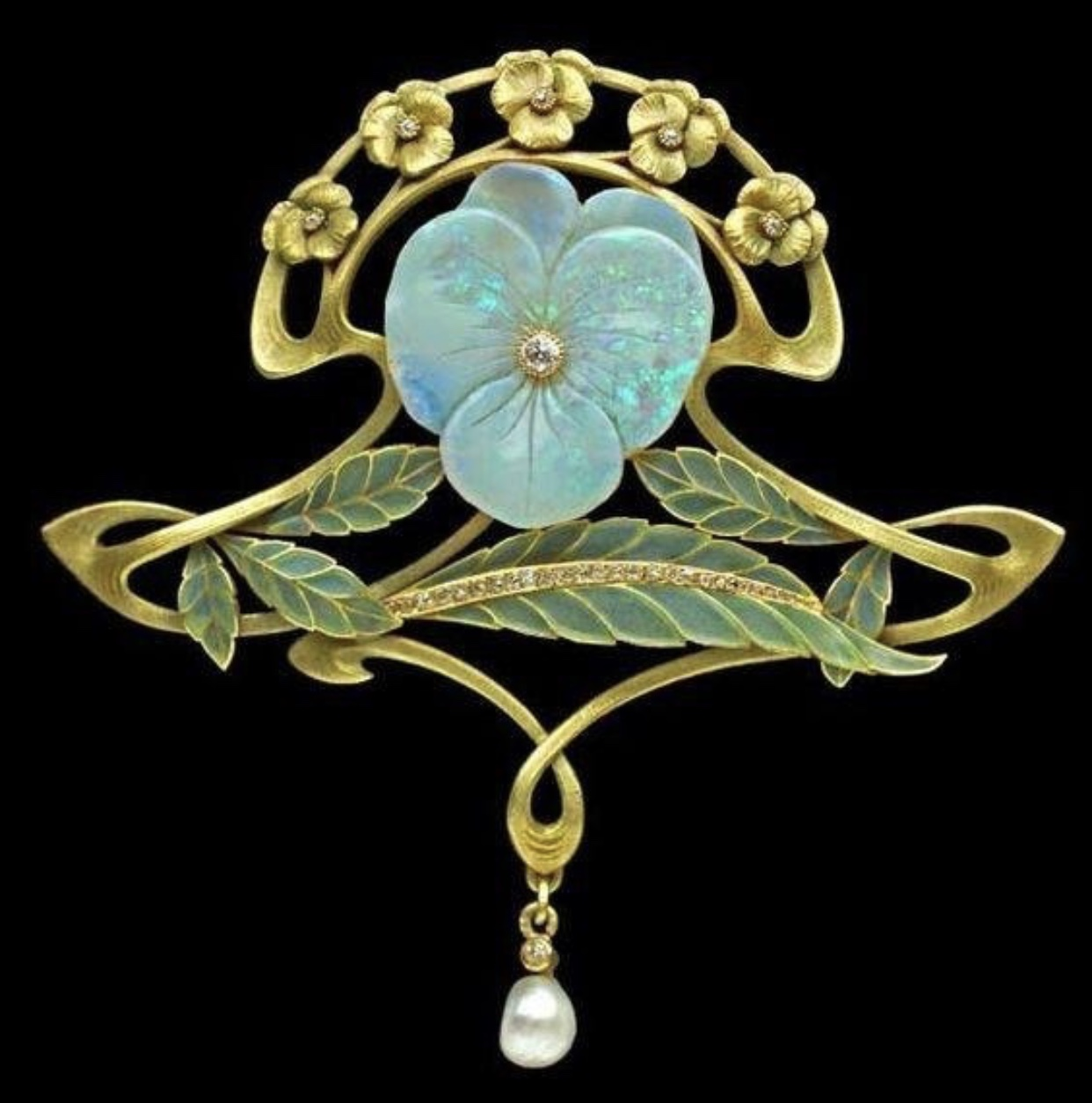 Plique-a-Jour - is an enameling technique in which transparent enamel is fired in cloisonné, so that light will show through. It's the stained glass window of jewelry.