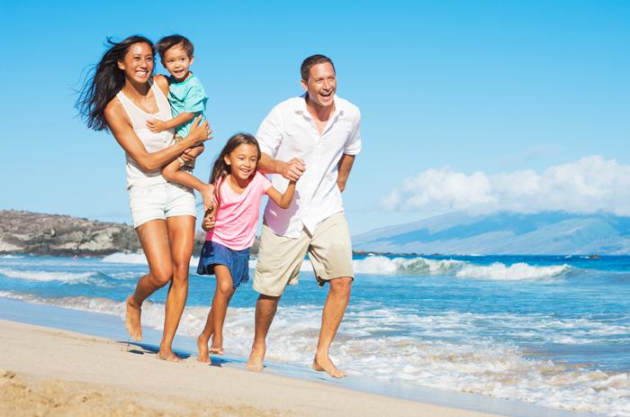 Happy-family-On-The-Beach-Family-Vacations.jpg
