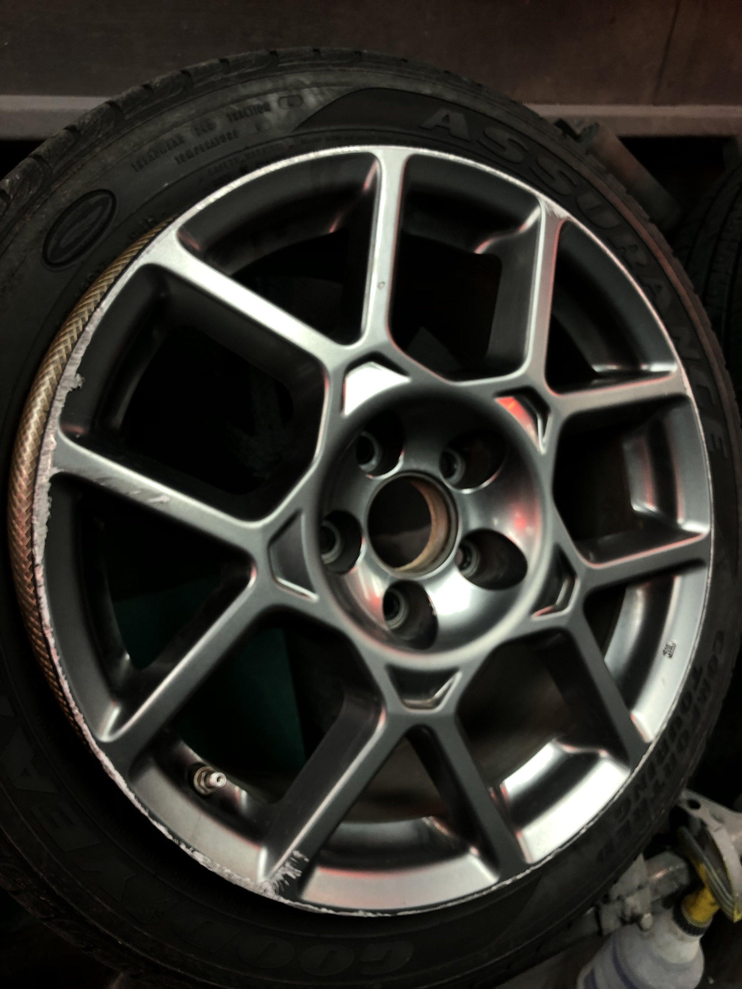 Acura TL before wheel repair & painting