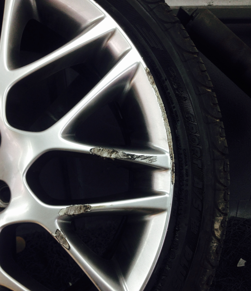 Curb rash before wheel repair
