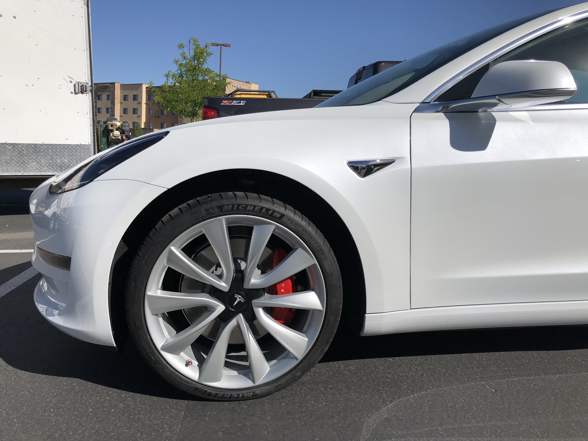 Tesla Model 3 after white wheel painting CU