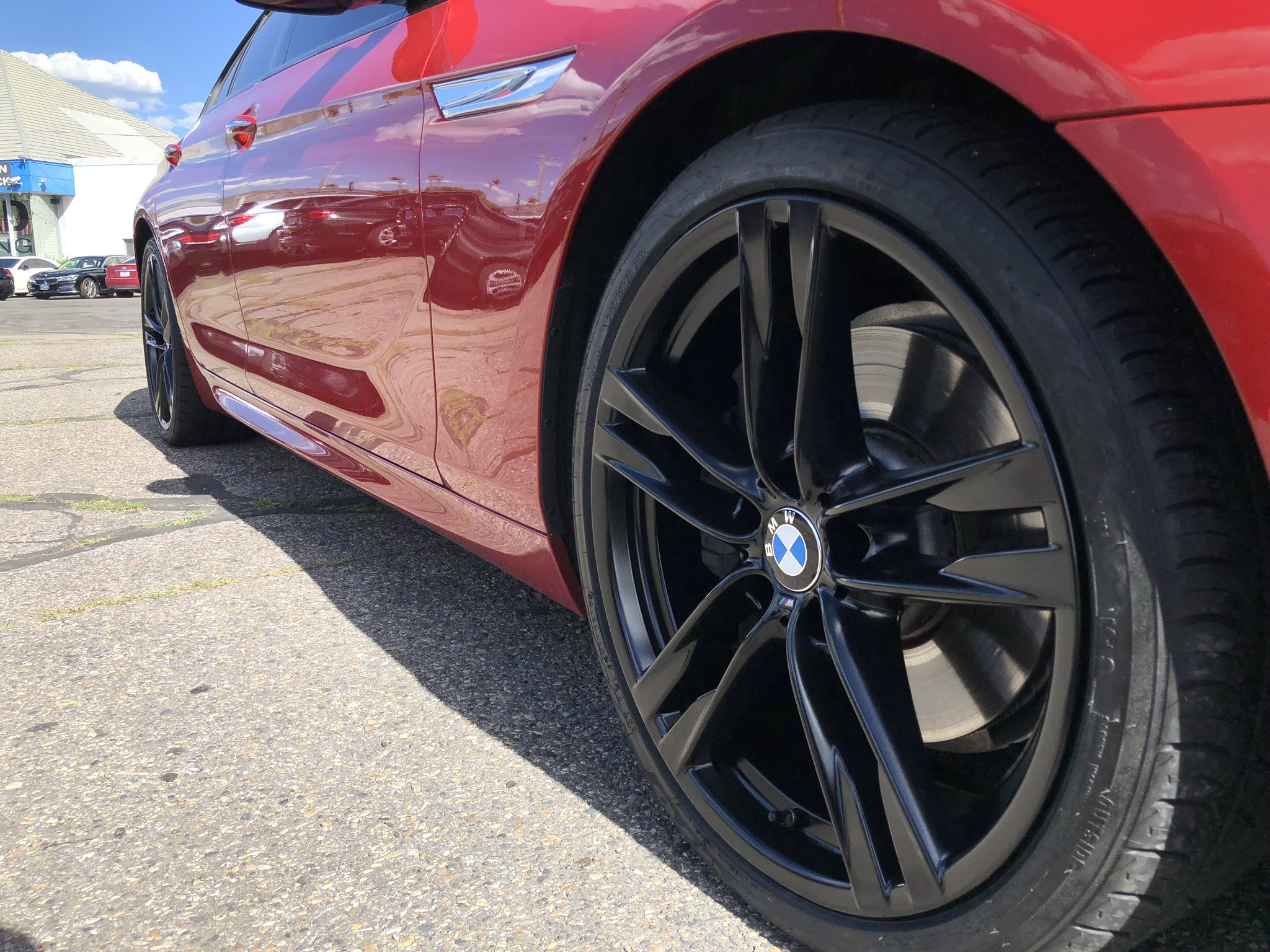 BMW 650i after satin black wheel painting