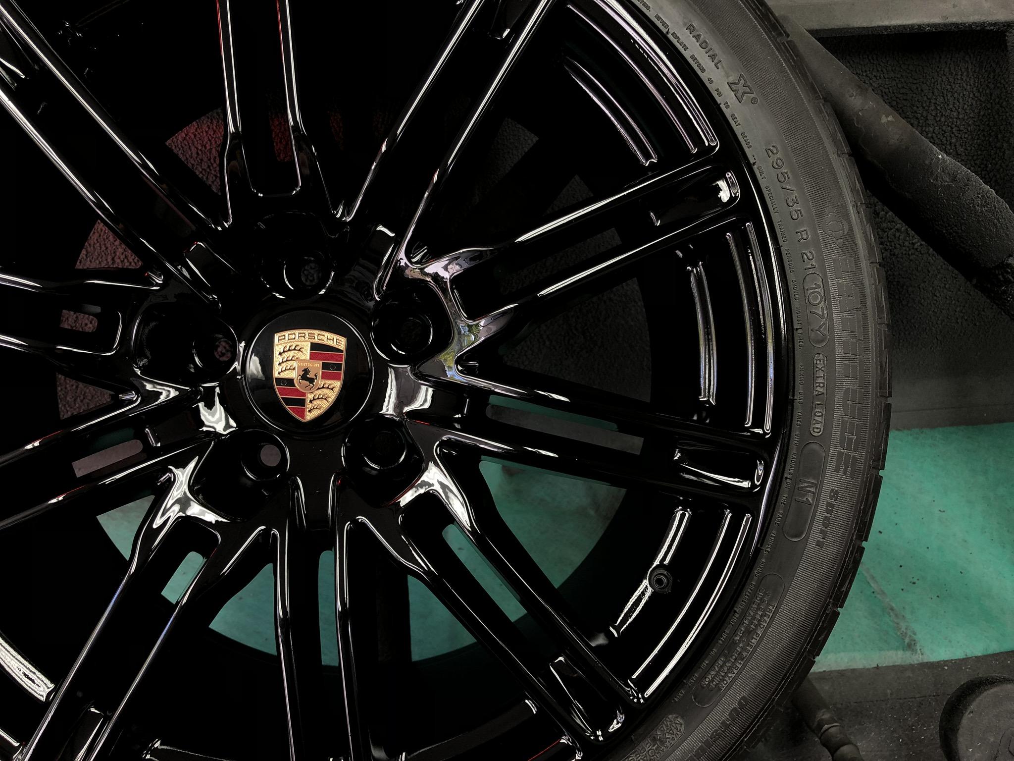 Porsche Cayenne after repair and black gloss paint