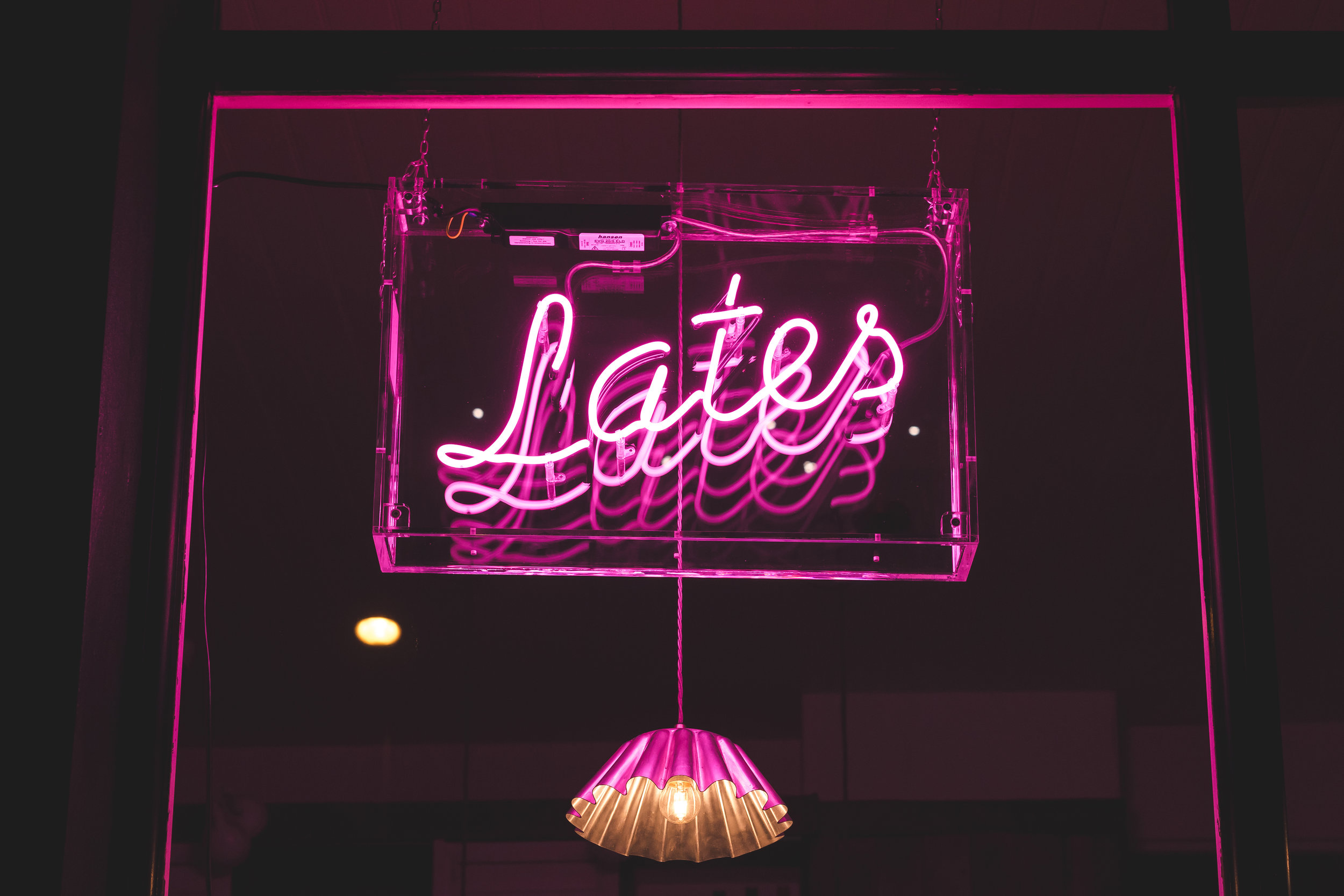 When the pink neon 'Lates' sign is on… - we're open - come down and say hi!