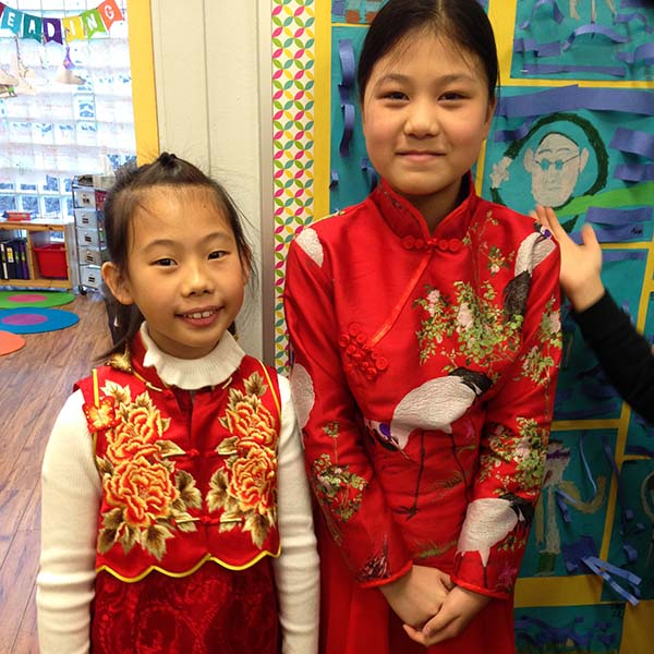 Students dressed in their traditional clothing for Chinese New Year.