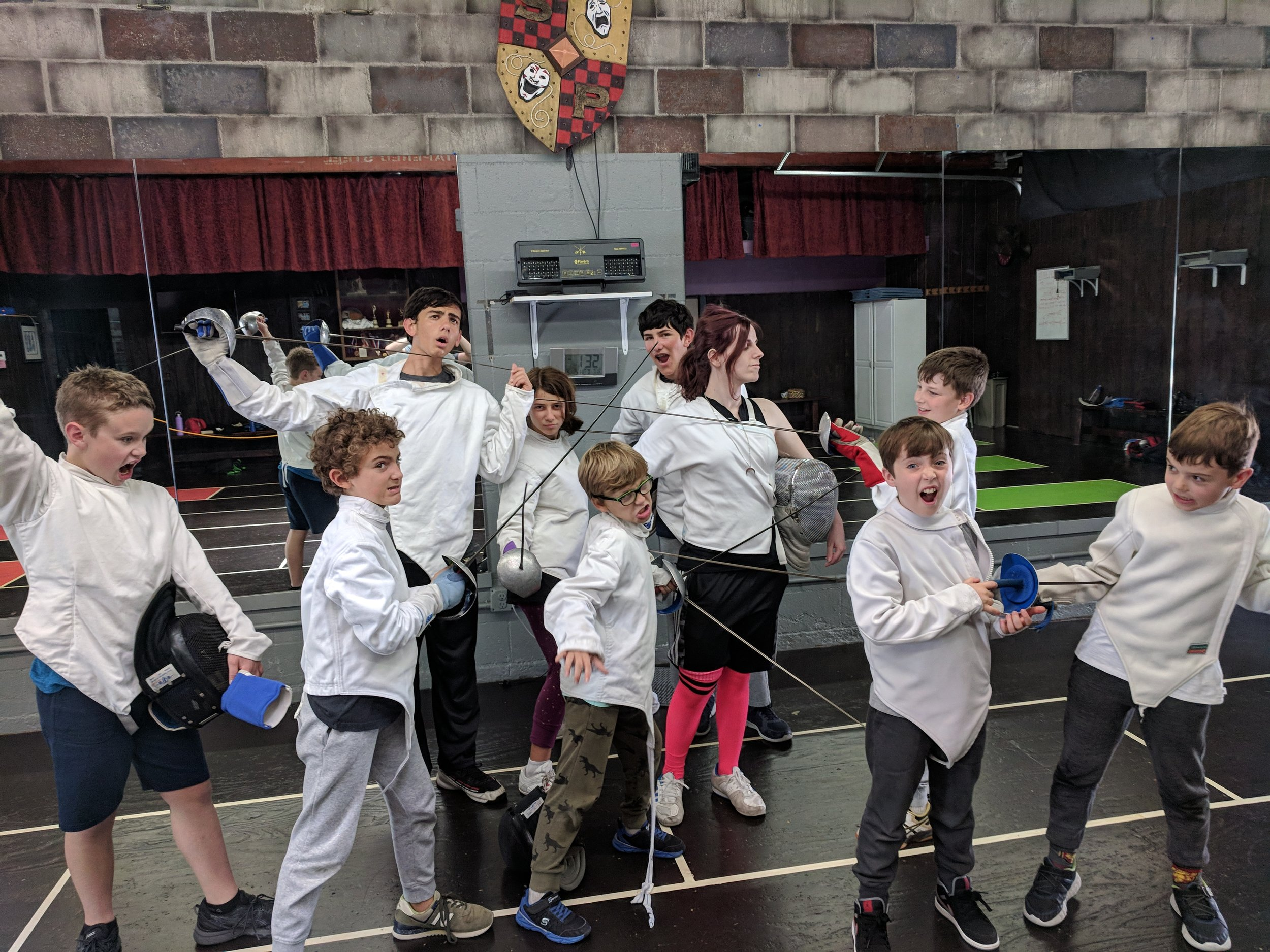 Fencing Camps (Ages 7-14) - Jump into en garde! Whether your kid is a first-time duelist or a practiced fencer, they'll have a ton of fun while they sharpen their skills on the piste. We teach our students through a combination of exercises, games, and sparring in a facility that has been optimized for the sport. Each fencing camp ends with a tournament and plenty of smiles.