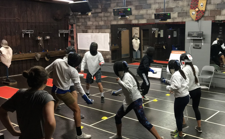 Team fencing game during a corporate fencing class at Swordplay LA fencing school