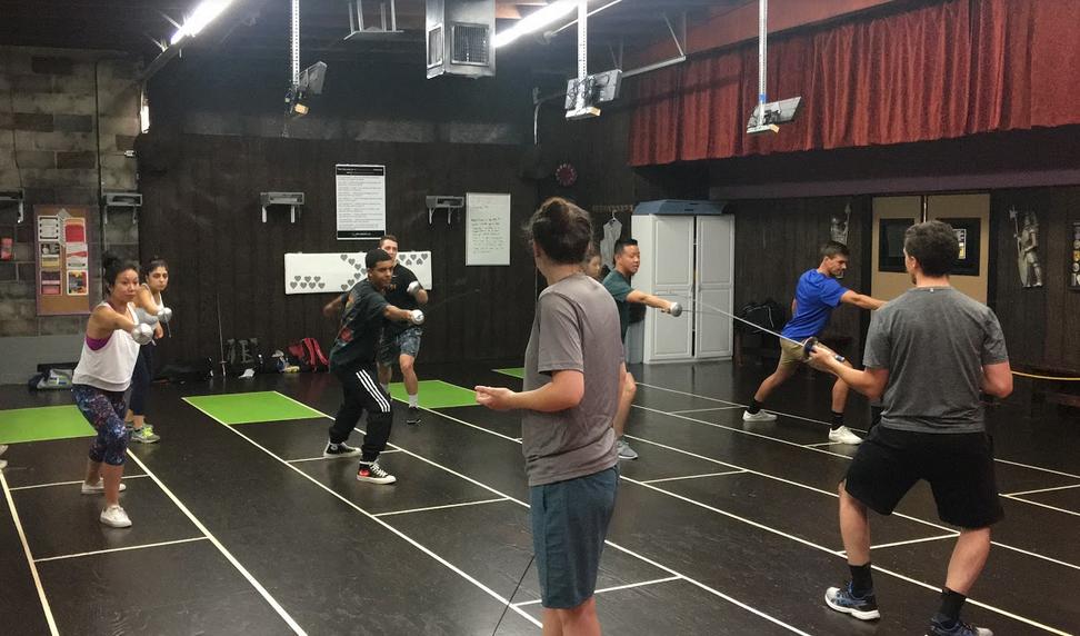 Swordplay LA coaches teaching a corporate fencing class