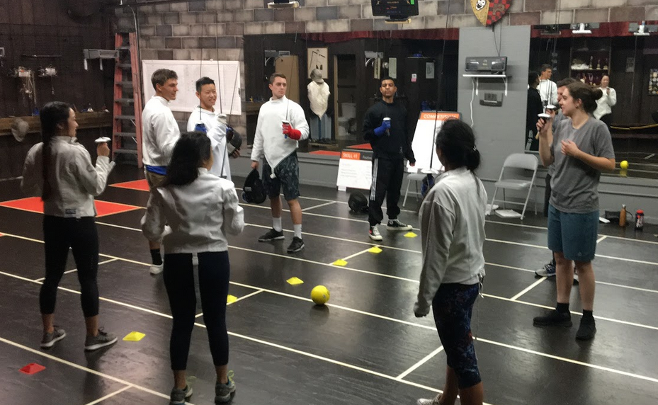Saluting at the end of fencing class at Swordplay LA