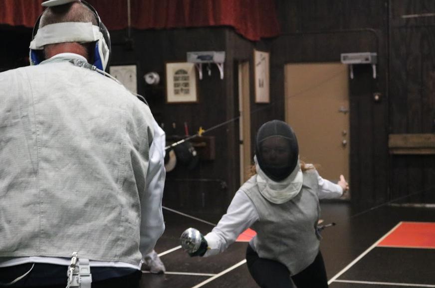 Teens and adults fencing at Swordplay LA fencing school
