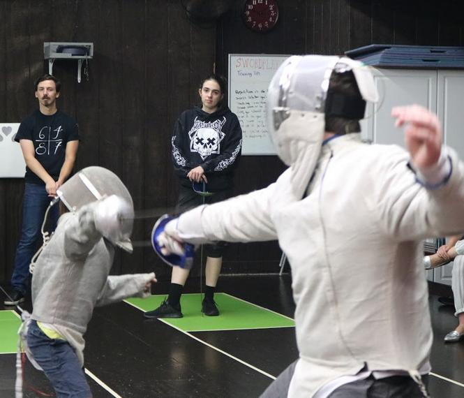 Competitive sabre fencers at Swordplay LA fencing school