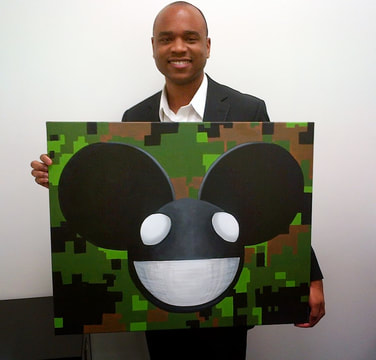 Chris receiving a custom hand painted gift from clients Nancy and Joel Zimmerman AKA Deadmau5.