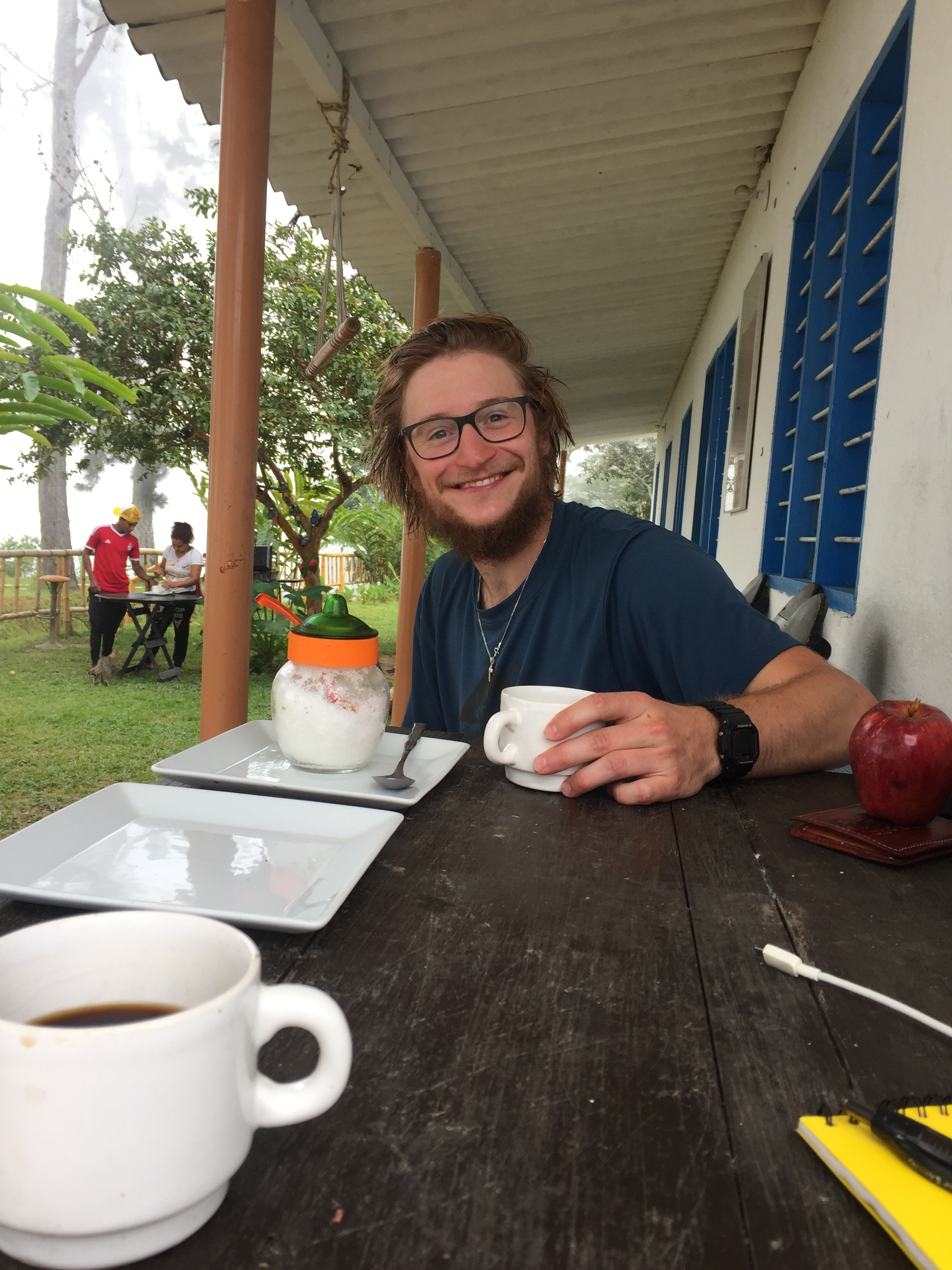 MINCA, COLOMBIA – JULY 26TH, 2017: My friend Bertie and I drink coffee at Hostel Los Pinos at the end of a 5 mile trek into the mountains. He was just one of the many charming people I met in Minca .