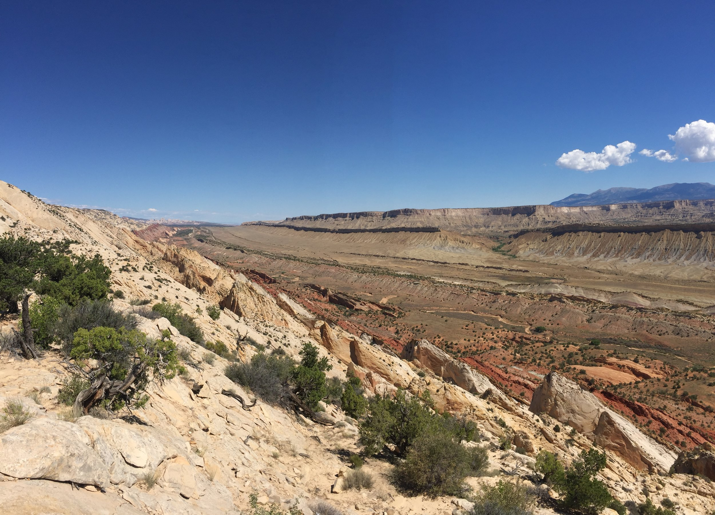 "AUGUST, 2017 – CAPITOL REEF NATIONAL PARK:  Pictured:   Capitol Reef is situated on a geological feature called a ""Monocline"" nicknamed the Waterpocket Fold – a ripple in the earth's crust 97 miles long."