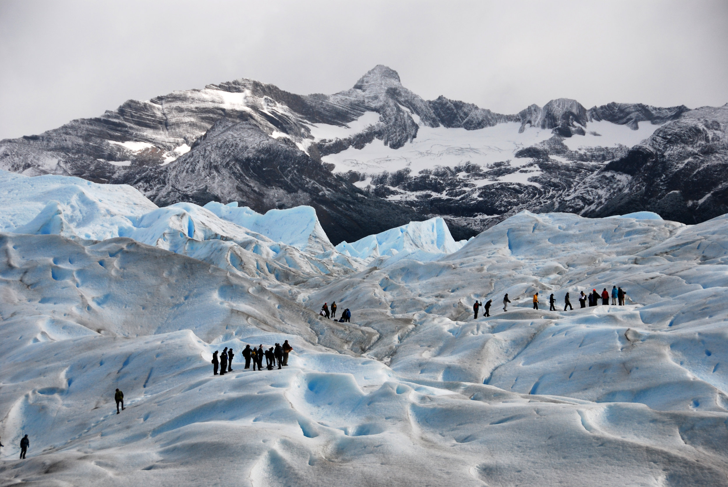 PICTURED:  Hikers on Perito Merino Glacier - Big Ice tour, Glaciers National Park, El Calafate, Argentina