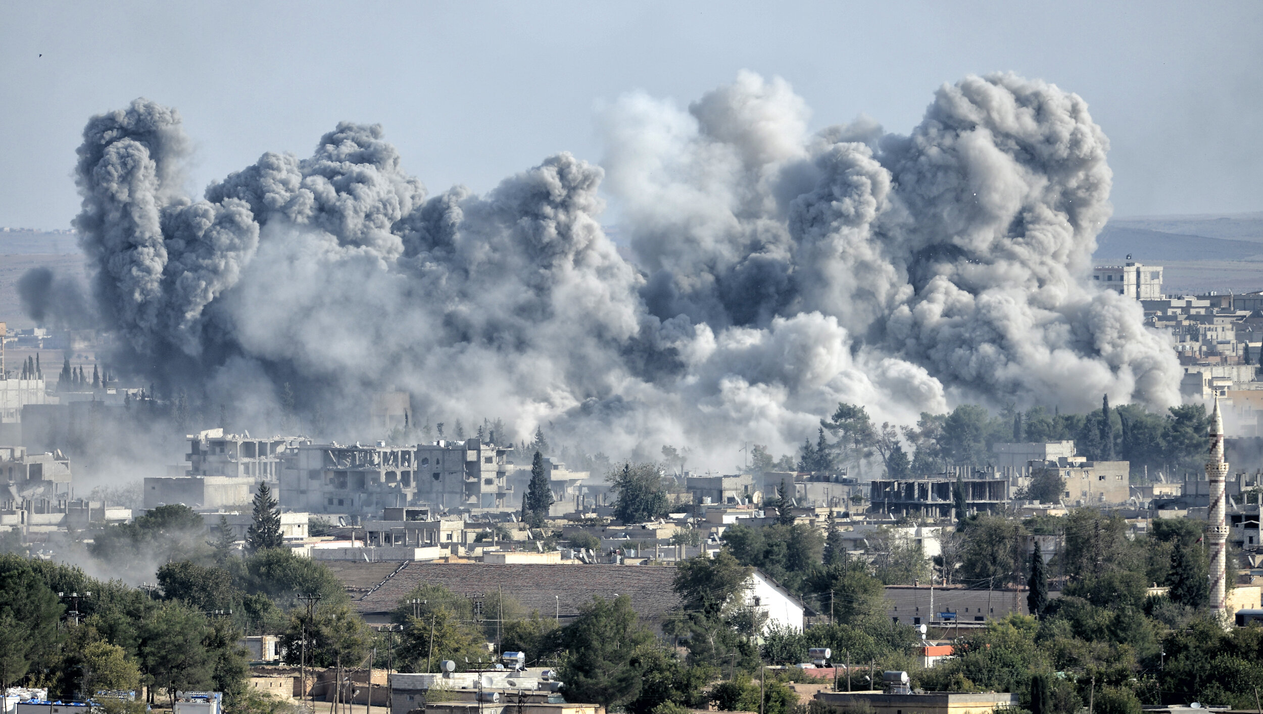 PICTURED:  An explosion after an apparent US-led coalition airstrike on Kobane, Syria, as seen from the Turkish side of the border.  Credit    Orlok   .