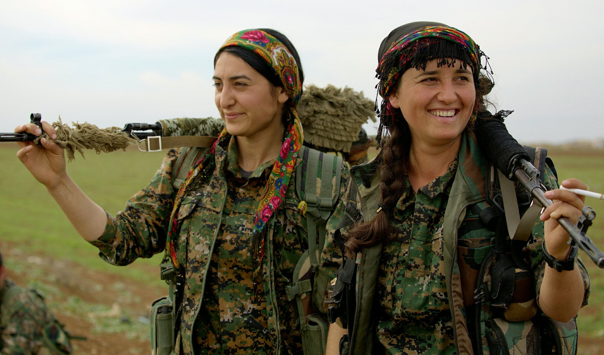 PICTURED:  Two Female Kurdish YPG fighters smile for the camera. Kurdish peoples are known to be more progressive than the societies in which they live, which includes their attitudes towards women's rights.  Photo Credit   Kurdish struggle ,  CC 2.0.