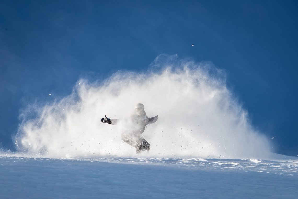 Happy in a powder ball. Heliboarding with Southern Lakes Heliski