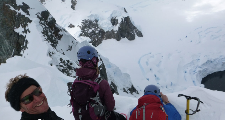 Phil Penny and a group of clients checking out the views after climbing one of the many peaks in Antarctica.