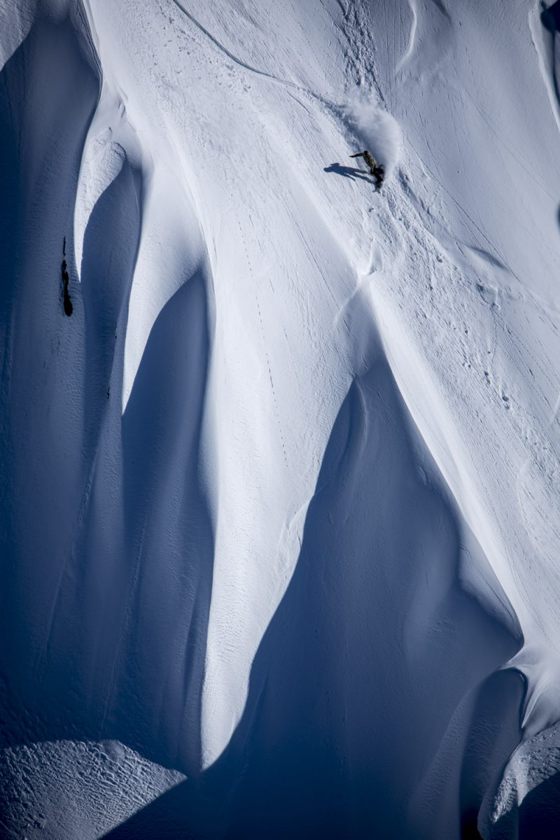 Enni Rukajarvi  dropping one of the big mountain lines with Southern Lakes Heliski