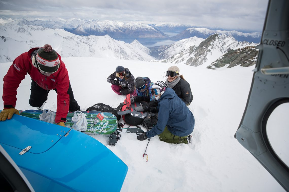 Exiting the helicopter, before a few powder turns above Lake Wanaka. Photo: Ashley Barker