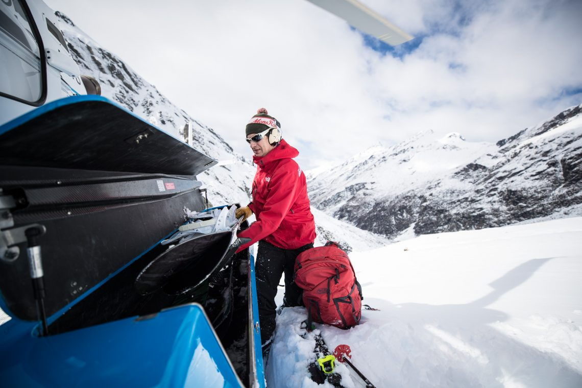 Chief  Guide James Hamilton  loading the helicopter for a day heliskiing in the New Zealand mountains. Photo:  Ashley Barker