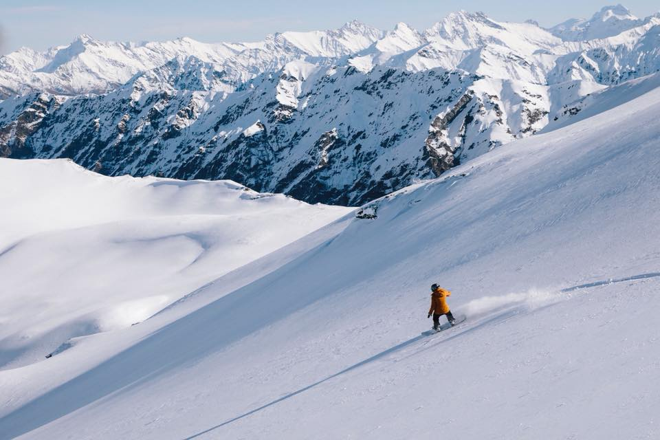 Liz Carlson (Young Adventuress) enjoying classic intermediate terrain on her first day ever heliskiing!