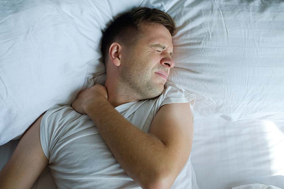iStock_Caucasian-young-man-having-terrible-pain-in-neck-in-bed-in-the-morning-926366048_3869x2579_Optimised.jpg