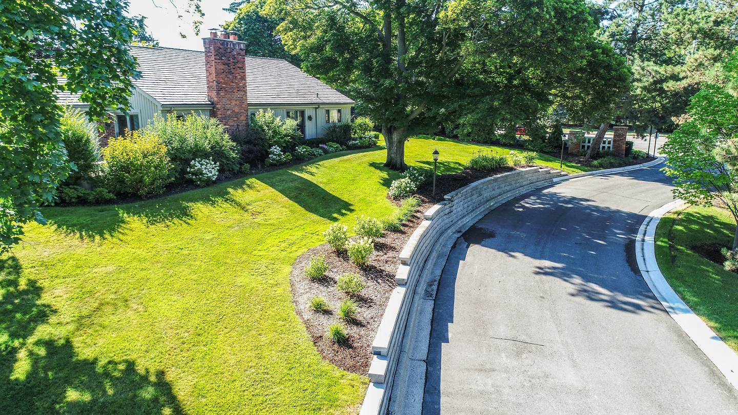 Lawn service next to retaining wall in Troy, MI