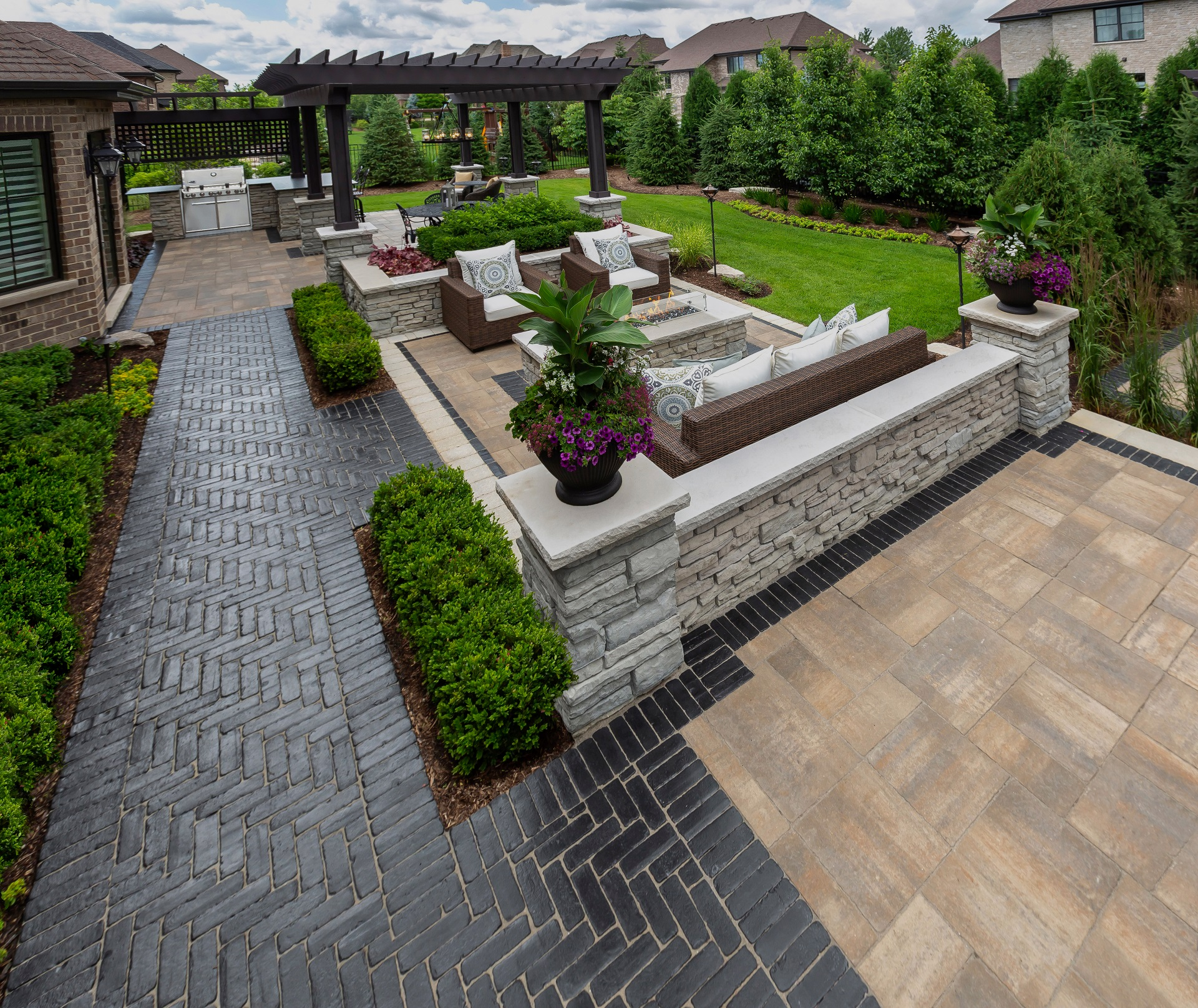 Stunning and durable retaining wall with top brick pavers in Troy, MI