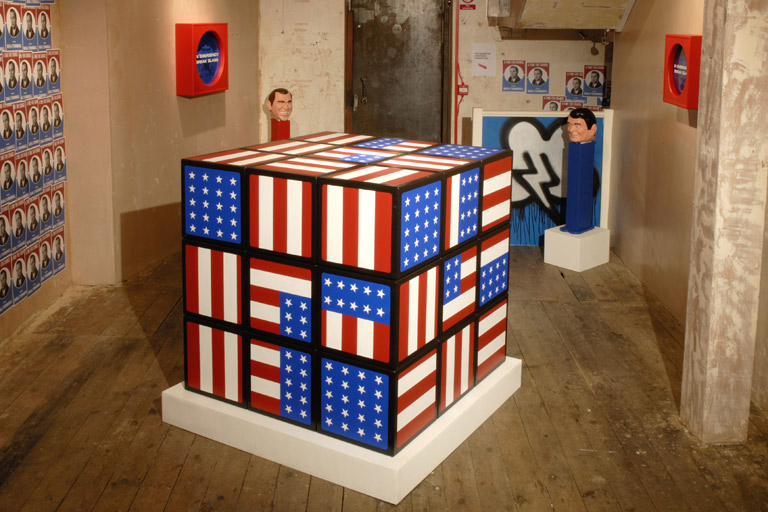 Installation view:  America (free),   106 x 106 x 106 cm/42 x 42 x 42 in (acrylic on wood), 2006
