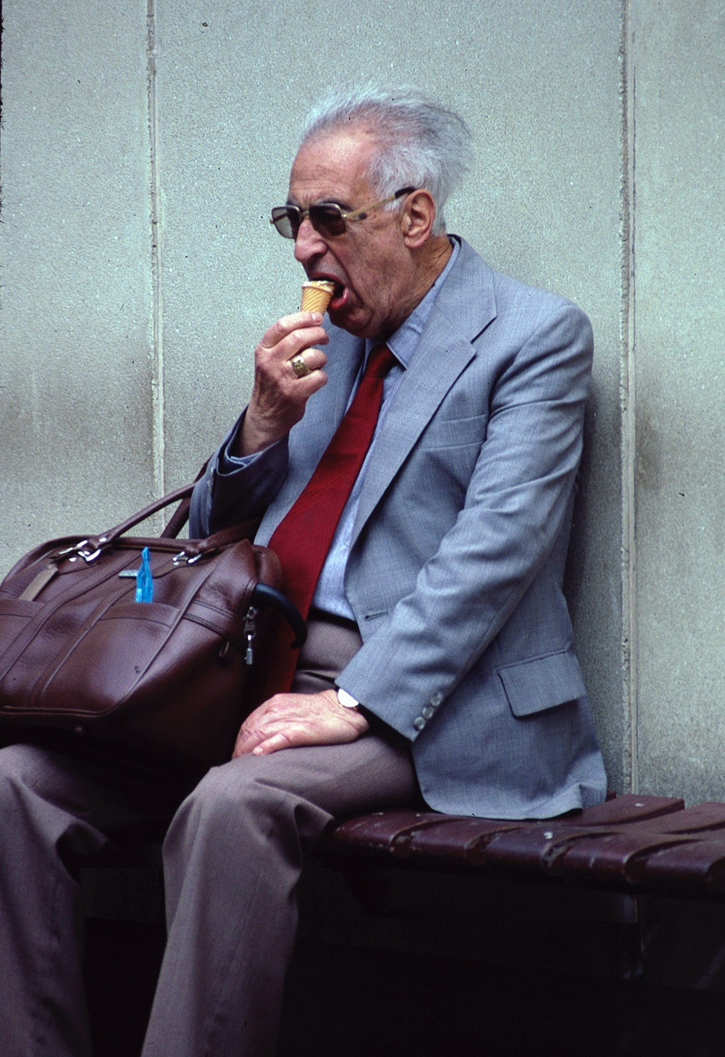 Older adult man enjoying an ice cream cone
