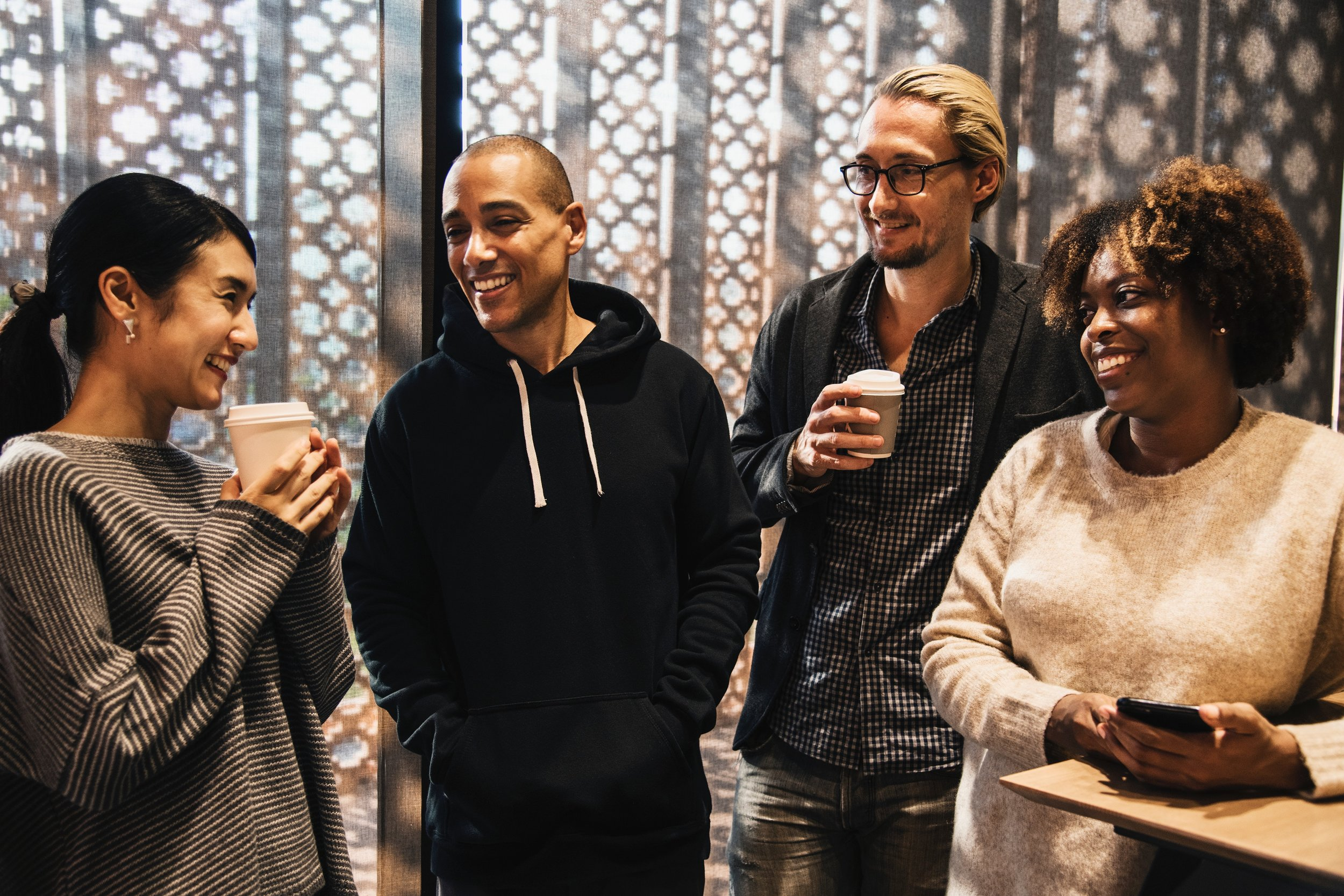 A group of people talking over coffee