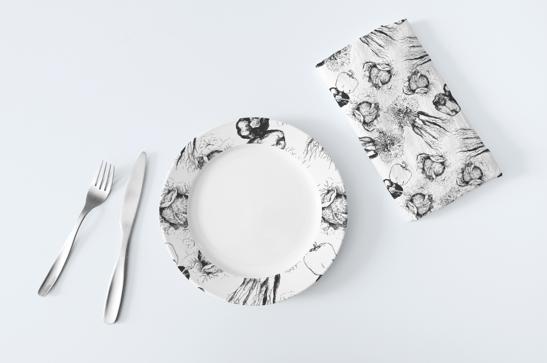 Simple line drawings done in black and white can make an elegant statement on paper goods, plates, fabric, gift wrap or even wall paper.