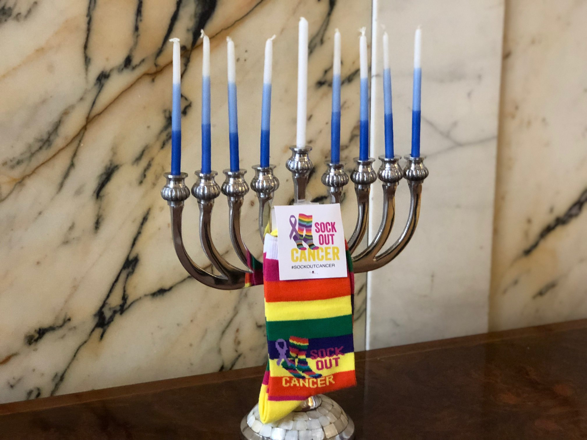 Sock Out Cancer socks and a menorah